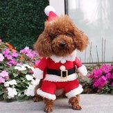 ペット犬の子犬のクリスマスの服アパレルサンタクロースの衣装の服装とクリスマスハット