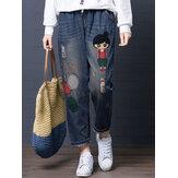 Bordado de dibujos animados Hueco cordón de la cintura Denim Jeans