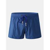 Pantalones cortos casuales de playa con cordón de secado rápido de color sólido para hombre con forro de compresión