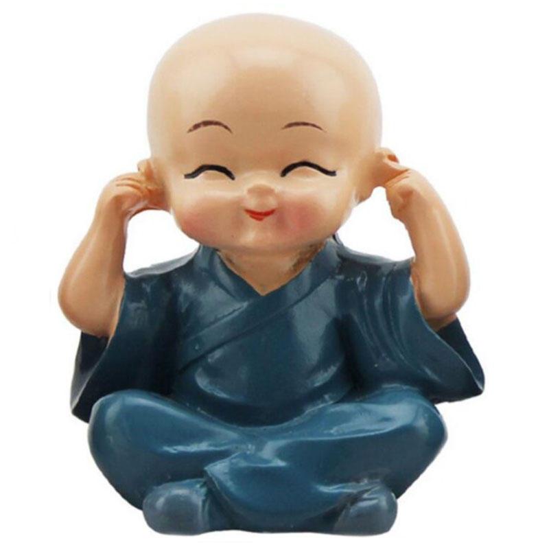 Los cuatro creativos no sacuden al pequeño monje budista Buda seguro Coche Decoración linda muñeca Coche Decoraciones